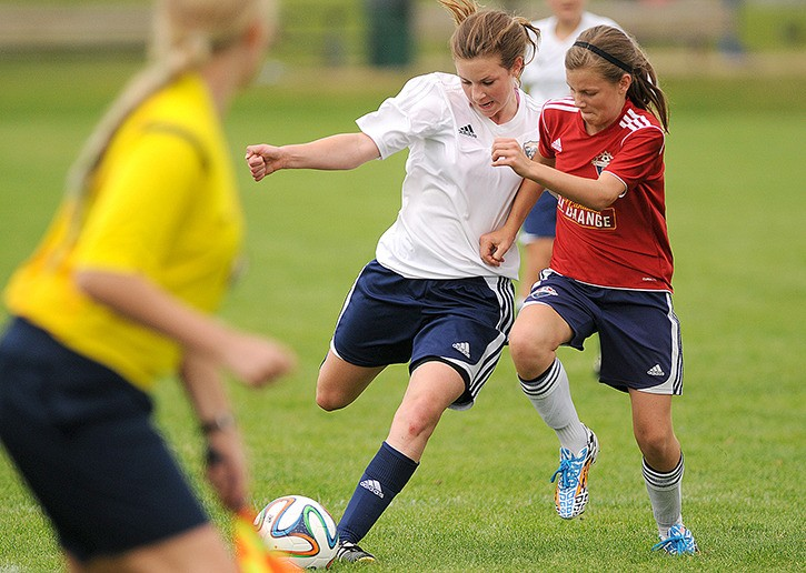 Alexis Klassen (right) of Chilliwack Attack goes up against a Nelson Selects player for the ball in a U-14 girls game during the B.C. Soccer Youth Provincial Championships tournament at Townsend Park on Saturday.