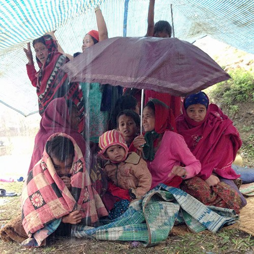 Villagers take shelter from the rain beneath tarps following Saturday's 7.8 magnitude earthquake in Nepal. Chilliwack residents Shaun Monty