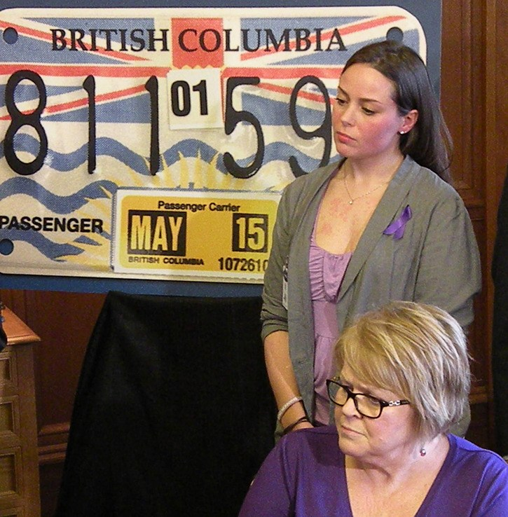 Danielle Raymond and her mother Julie attend announcement by Transportation Minister Todd Stone to increase regulation of party buses before this spring's high school graduation.