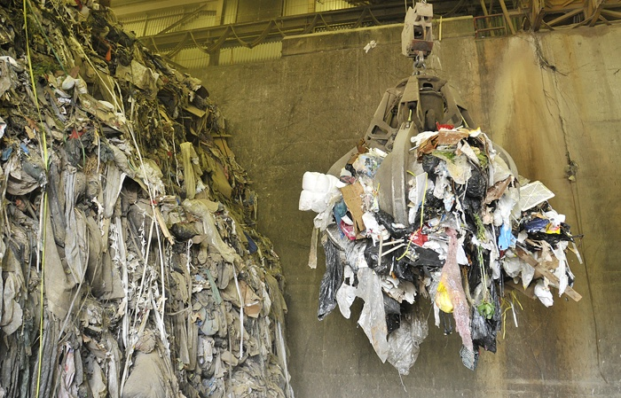 A crane lifts a load of garbage at Metro Vancouver's Burnaby Waste To Energy Facility. One Metro director hopes waste from apartments will be sorted at new material recovery facilities instead of being burned in a new incinerator.