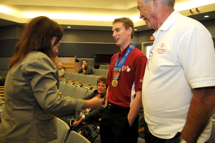 Local swimmer Ryan Kuester is congratulated by Mayor Sharon Gaetz for his two gold medals that he won for backstroke and freestyle at the 2011 Special Olympics World Summer Games in Athens. Kuester was acknowledged for his achievements and given a gift during Tuesday afternoon's council meeting at City Hall.