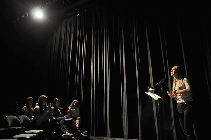 Kelsey Carlson recites her poem during Sardis secondary's Behind the Curtain poetry event at the school on Wednesday.