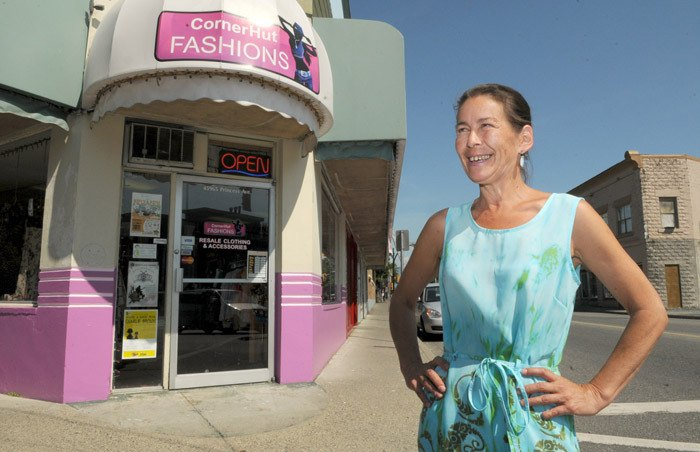 Twyla Johnson outside her pink painted store at Young and Princess