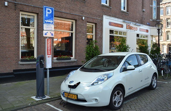 A Nissan Leaf at an electric charging station in Amsterdam. The Leaf is one of the plug-in electric vehicles that will be eligible for B.C. rebates starting in December.