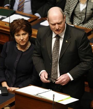 Premier Christy Clark listens as Finance Minister Mike de Jong presents the 2014-15 budget in the B.C. legislature Tuesday.