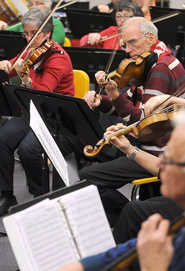 Members of the Chilliwack Metropolitan Orchestra rehearse in preparation for their Dec. 20 Christmas concert at the Cultural Centre.