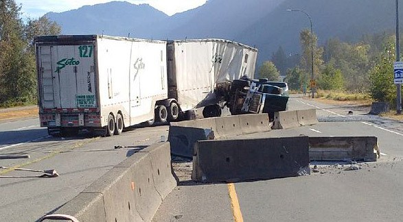 An LNG fueled transport truck crashed through the concrete barrier on Highway 1 near Bridal Falls Monday morning.