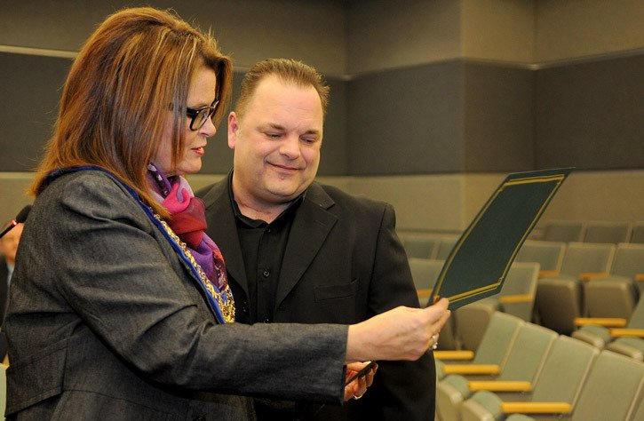 Chilliwack resident Shawn Nagurny (seen here with Mayor Sharon Gaetz) was recognized during Tuesday's city council meeting for his heroic efforts in rescuing people from a burning plane after it crashed in Richmond in October.