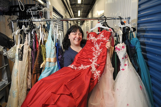 Carolyn Burgh shows off some of the dresses she has in storage for The Graduate Wardrobe