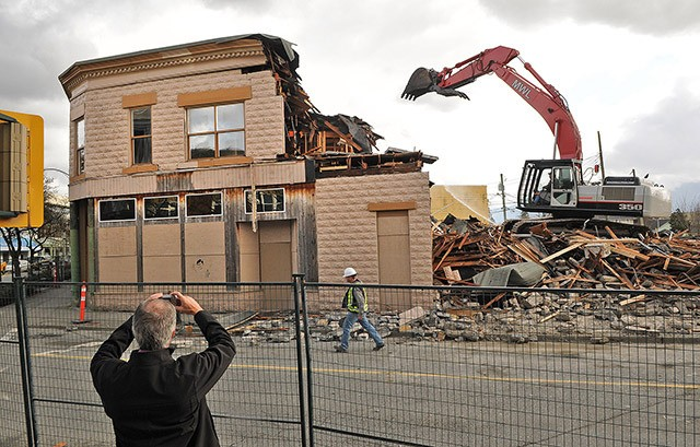 Spectators watch as the Irwin Block comes down last March. The B.C. Supreme Court has ordered the City of Chilliwack to pay the property owner an additional $220