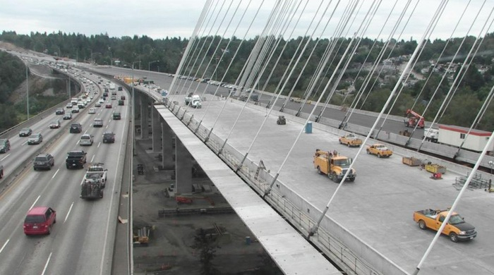 The new Port Mann Bridge (right) opens in December with eight of 10 lanes operational. The final two lanes can't be used until the old bridge is dismantled.