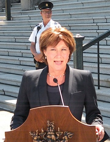 Legislature security guards watch as Premier Christy Clark comments on arrests in apparent terrorist bomb plot targeting Canada Day ceremonies at the B.C. legislature.