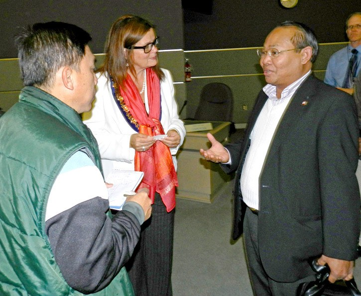 Chilliwack Mayor Sharon Gaetz chats informally with Cambodian Ministry of the Interior official Ev Bunthol (right) during a reception at city hall Thursday.