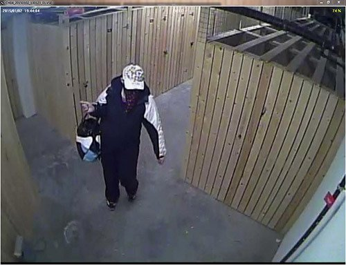 One of two suspects caught on video tape at a Garrison apartment building. RCMP are hoping the public can identify the person here based on her clothing.