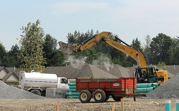 Crews work on a subdivision development located just north of a 600-metre section of the Rotary Trail at Peach Road that is being reinforced to prevent future flood damage. The temporary trail detour is picture below.