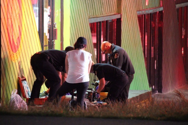 First responders treat an overdose victim in Surrey.