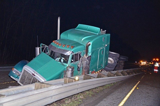 A semi-trailer tractor unit took out the median on Highway 1 Tuesday night.