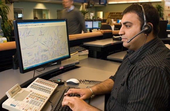 E-Comm dispatcher taking 911 calls.