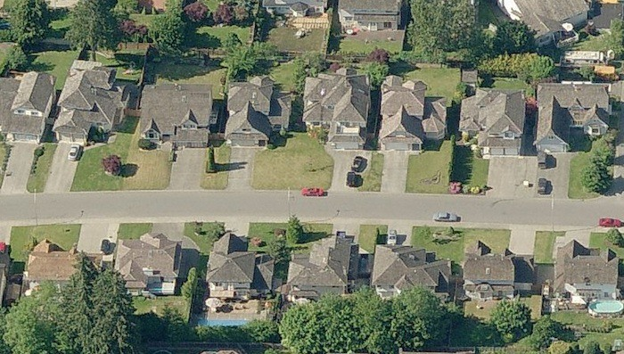 A couple living on this block of 77A street in Surrey say they and most of their neighbours have seen the house size on their property assessment go up this year.