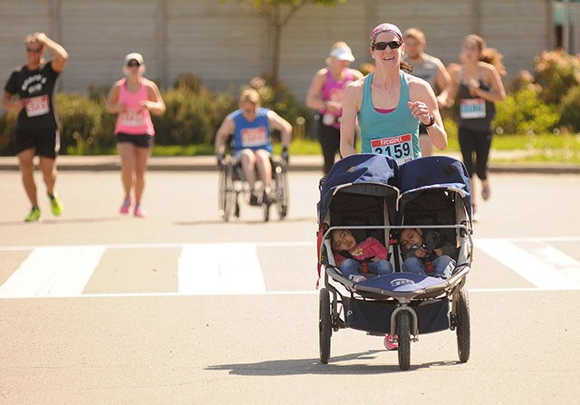 Carli Ricka races to the finish line while pushing her twins