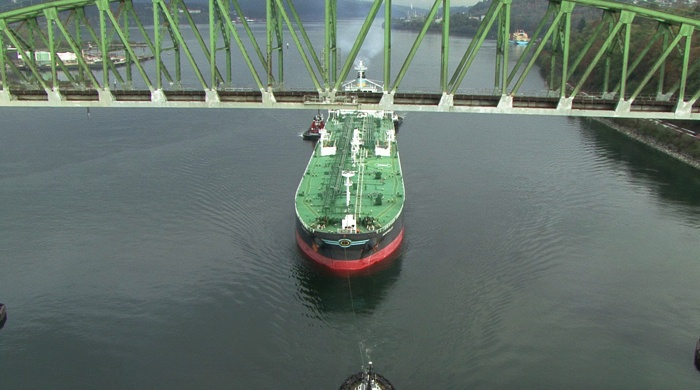 An oil tanker heads through the Second Narrows