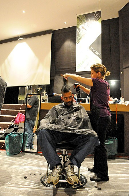 Hair stylist Kim Eeg of Undine's gives William Wingert a mohawk haircut during the third annual Chilliwack Connect at First Avenue Christian Assembly on Saturday morning. More than 200 volunteers came out to the event to offer free hair cuts