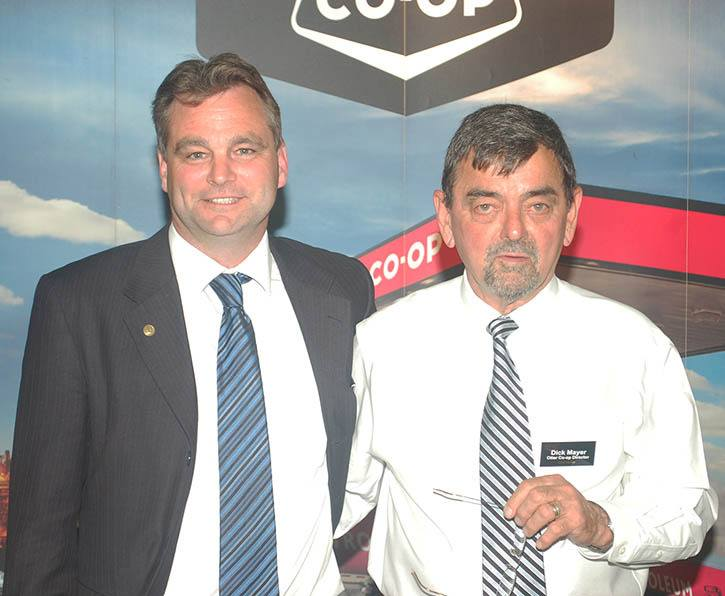 Otter Co-op's general manager Jack Nicholson (left) received his 25 year service award from the co-op's president Dick Mayer at the annual general meeting