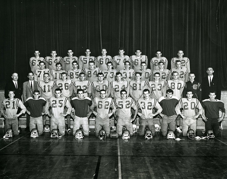 Jack Covey (far right in the dark suit) looked dapper in a Chilliwack secondary school football team picture. Over six-plus decades the former teacher/school administrator has had an impact on hundreds of Chilliwack youths in dozens of activities.