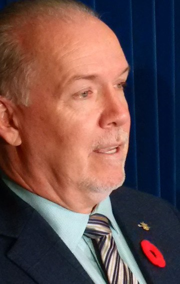 NDP leader John Horgan speaks to reporters in Victoria Wednesday.