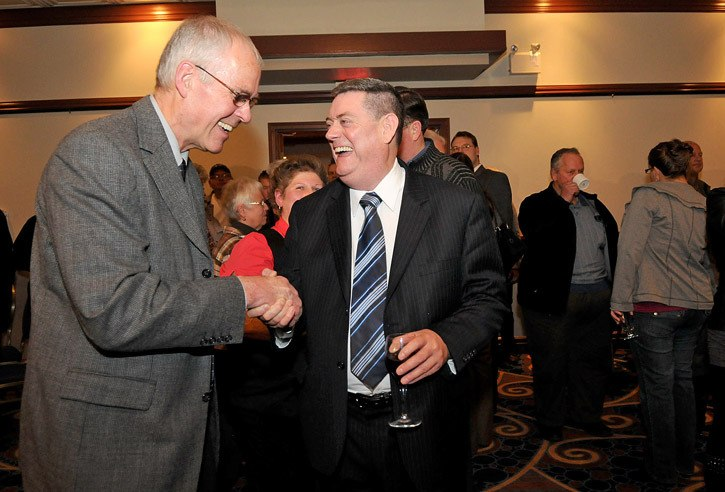 Ron Browne (left) congratulates councillor Stewart McLean on election night at the Best Western on Nov. 19. It was a tight race between the two as McLean got only 117 votes more than Browne.
