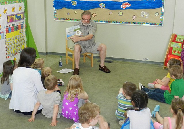 Rick Mawson reads Josh The Baby Otter to children at Noah's Ark Preschool. The Rotary Club of Chilliwack has purchased several copies of the water safety book and will be giving them away.