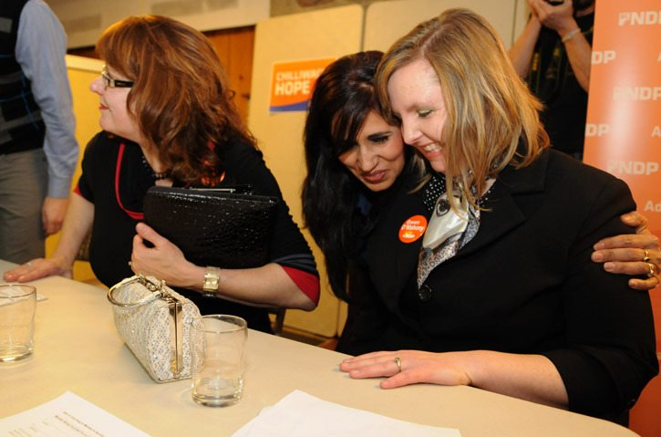 Gwen O'Mahoney is congratulated after being voted in by NDP members as the candidate for Chilliwack-Hope at the Mt. Cheam Lions Hall on Saturday. The other two nomination candidates were Dennis Adamson and Kathleen Stephany.
