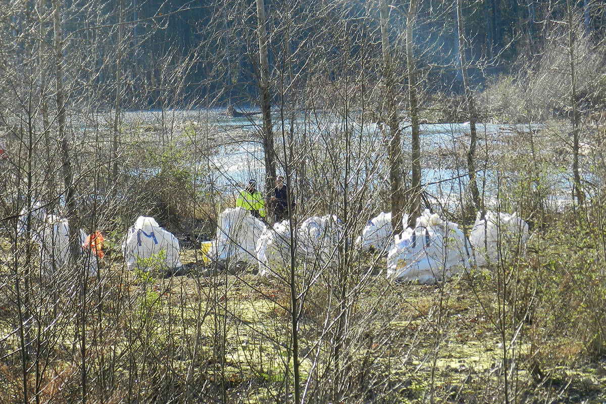 A helicopter hired by the province removed 50 totes and four nets from a notorious homeless camp on the Chilliwack River on Dec. 6. Garbage from that and another camp on the Fraser River came in at more than 21,000 pounds.