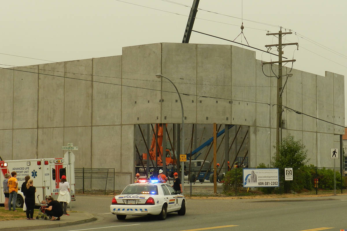 The scene on Luckakuck Way on Sept. 7, 2017 when a worker was seriously injured after a crane lifting a metal bar came in close proximity to high voltage wires. (Greg Knill/ Progress file)