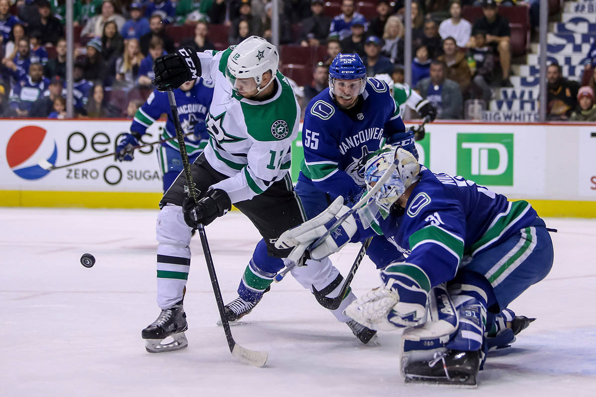 Dallas Stars' Radek Faksa (12) is stopped by Vancouver Canucks goaltender Anders Nilsson (31) during first period NHL hockey action in Vancouver on Saturday, Dec. 1, 2018. THE CANADIAN PRESS/Ben Nelms