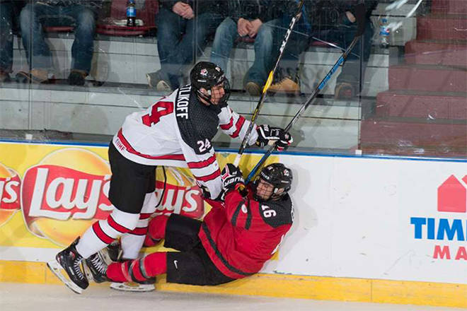 Alex Swetlikoff (Vernon Vipers, BCHL), left, runs over a Team Canada East player during Monday night's all-Canadian preliminary game at the 2018 World Junior A Challenge. Team Canada West won the game 6-1. Photo courtesy of Matthew Murnaghan/Hockey Canada Images