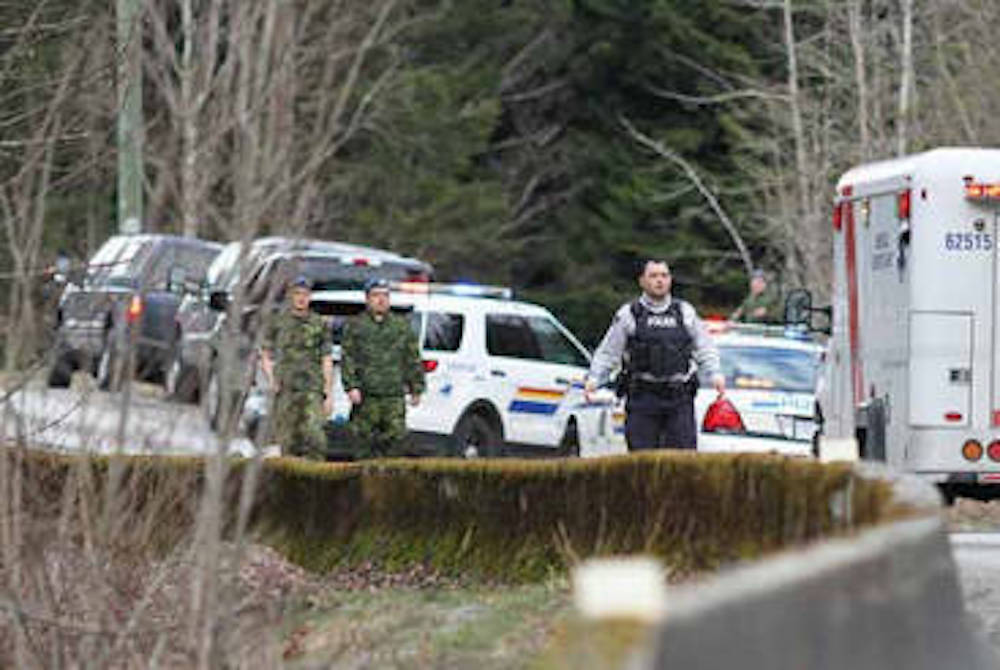 Police turned back traffic at the Borden Creek bridge in the Chilliwack River Valley on March 25, 2017 after a bizarre string of shootings culminating in an arrest of Peter Anthony Kampos. (Greg Laychak/ Black Press)