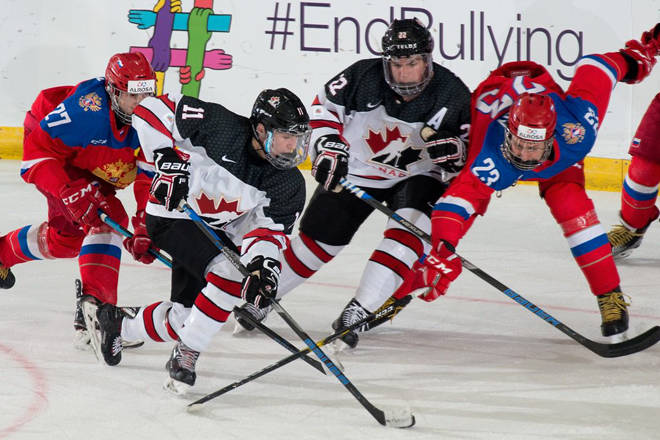 Team Canada West player Alexander Campbell (Victoria Grizzlies, BCHL) races the puck up the ice through traffic, while teammate Alex Newhook tries to give him some space. Canada West lost to Russia 3-0 on Wednesday night in the preliminary round of the World Junior A Challenge.                                Hockey Canada images