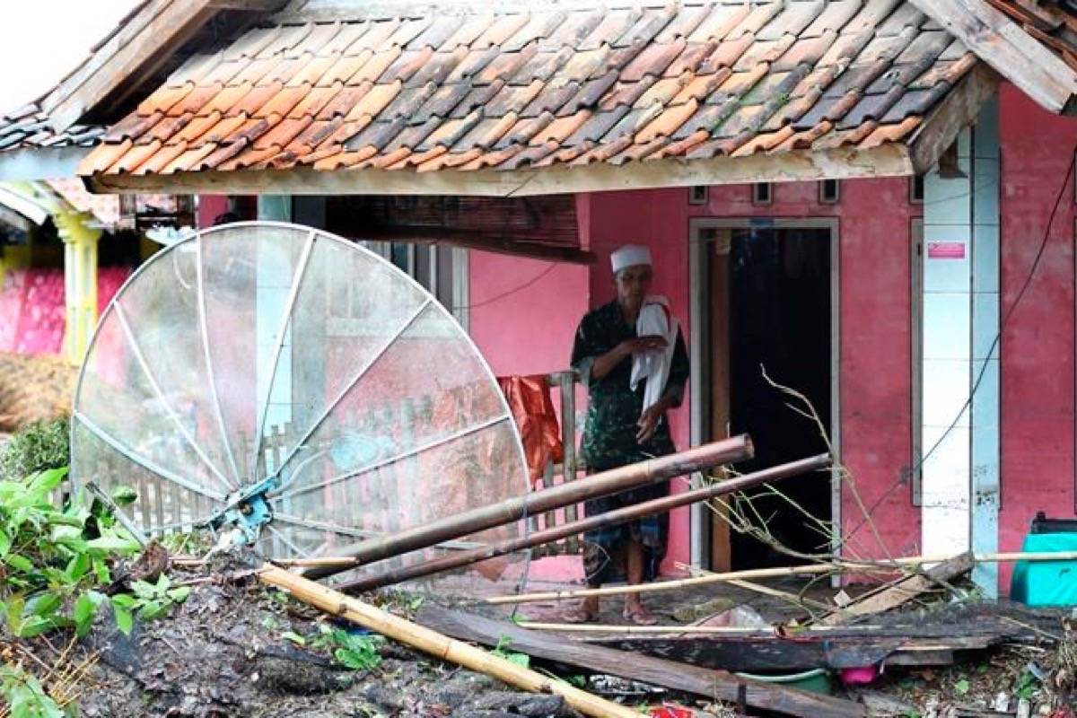A resident inspects his house damaged by a tsunami, in Sumur village, Indonesia, Monday, Dec. 24, 2018. The tsunami apparently caused by the eruption of an island volcano killed a number of people around Indonesia's Sunda Strait, sending a wall of water crashing some 65 feet (20 meters) inland and sweeping away hundreds of houses including hotels, the government and witnesses said. (AP Photo/Tatan Syuflana)