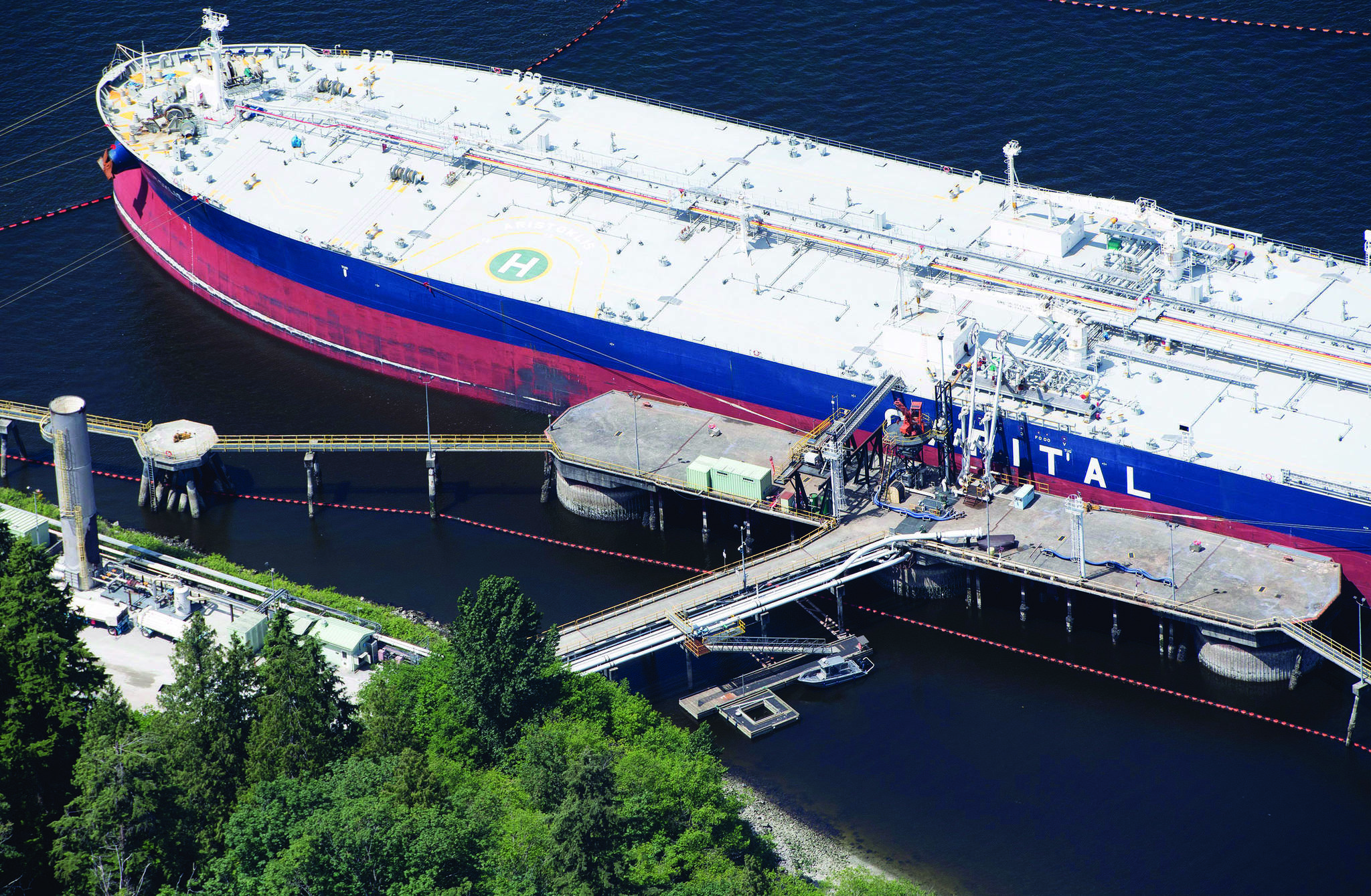 A aerial view of Kinder Morgan's Trans Mountain marine terminal filling a oil tanker in Burnaby, B.C., is shown on Tuesday, May 29, 2018.THE CANADIAN PRESS Jonathan Hayward