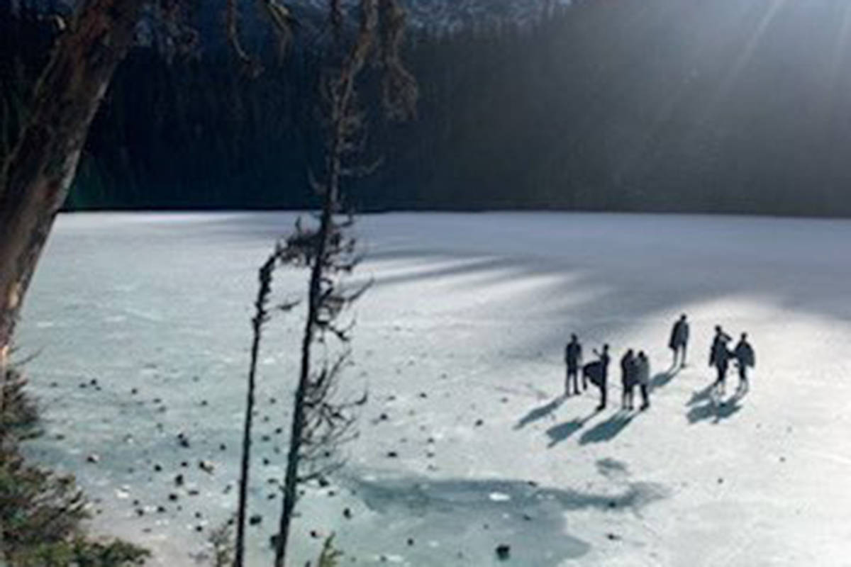 A group of people seen on top of thin ice at Joffre Lakes on Nov. 10, 2019. (Whistler RCMP)