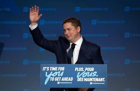 Conservative Leader Andrew Scheer acknowledges supporters following a speech on election night at party campaign headquarters in Regina, Tuesday, October 22, 2019. THE CANADIAN PRESS/Adrian Wyld