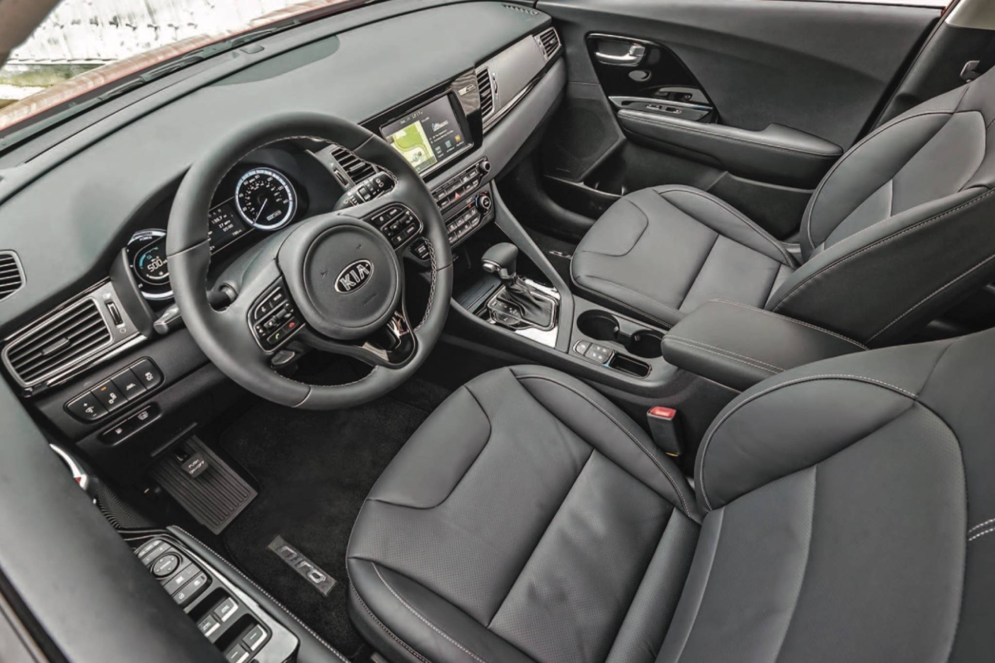 The Niro might be a high-tech machine, but the designers clearly wanted to give the impression of a normal vehicle with familiar features and shapes. It might seem odd that there's an actual shift lever, but this is the hybrid and not the EV model that has a single-speed controller instead of a transmission. Photo: KIA