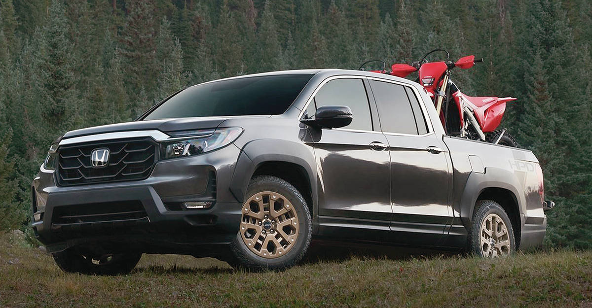The revamped Honda Ridgeline has a much more aggressive front end, while these nifty bronze wheels are optional. PHOTO: HONDA