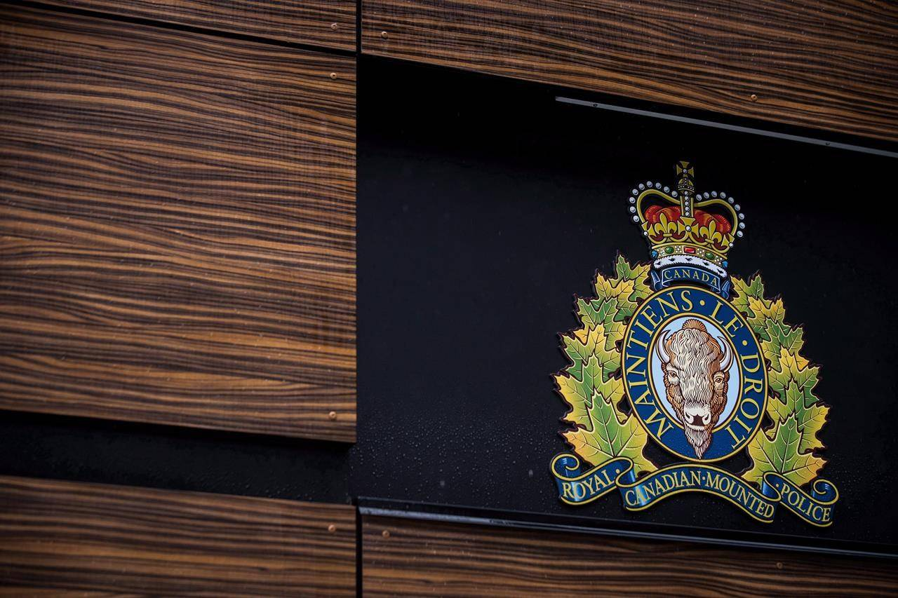 """The RCMP logo is seen outside Royal Canadian Mounted Police """"E"""" Division Headquarters, in Surrey, B.C., on Friday April 13, 2018. Indigenous leaders are calling for an investigation into the conduct of Mounties on Vancouver Island after two police shootings of members of a small First Nations community in three months. THE CANADIAN PRESS/Darryl Dyck"""