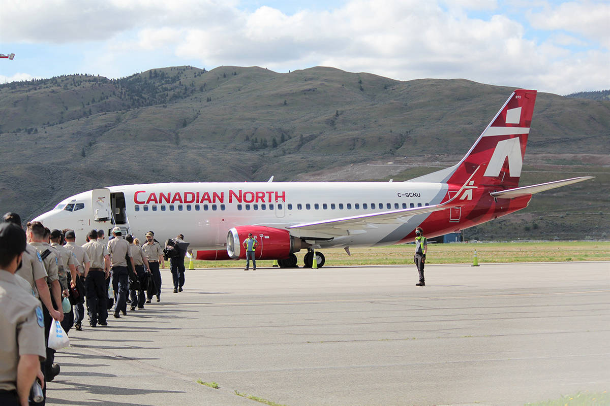 BC Wildfire Service crew members board a plane Wednesday, May 26 headed to Manitoba to help firefighting efforts in the province. (BC Wildfire Service photo)