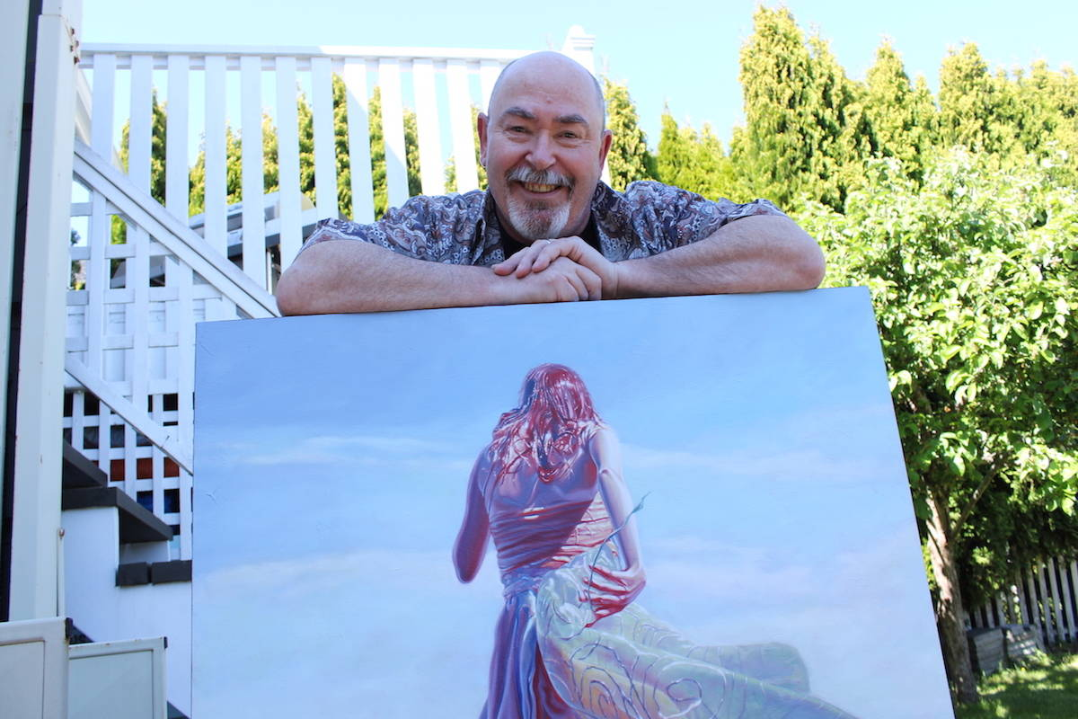 Mark Heine with a painting from his Sirens series. Two pieces from the series will go to the moon later this year. (Jake Romphf/News Staff)