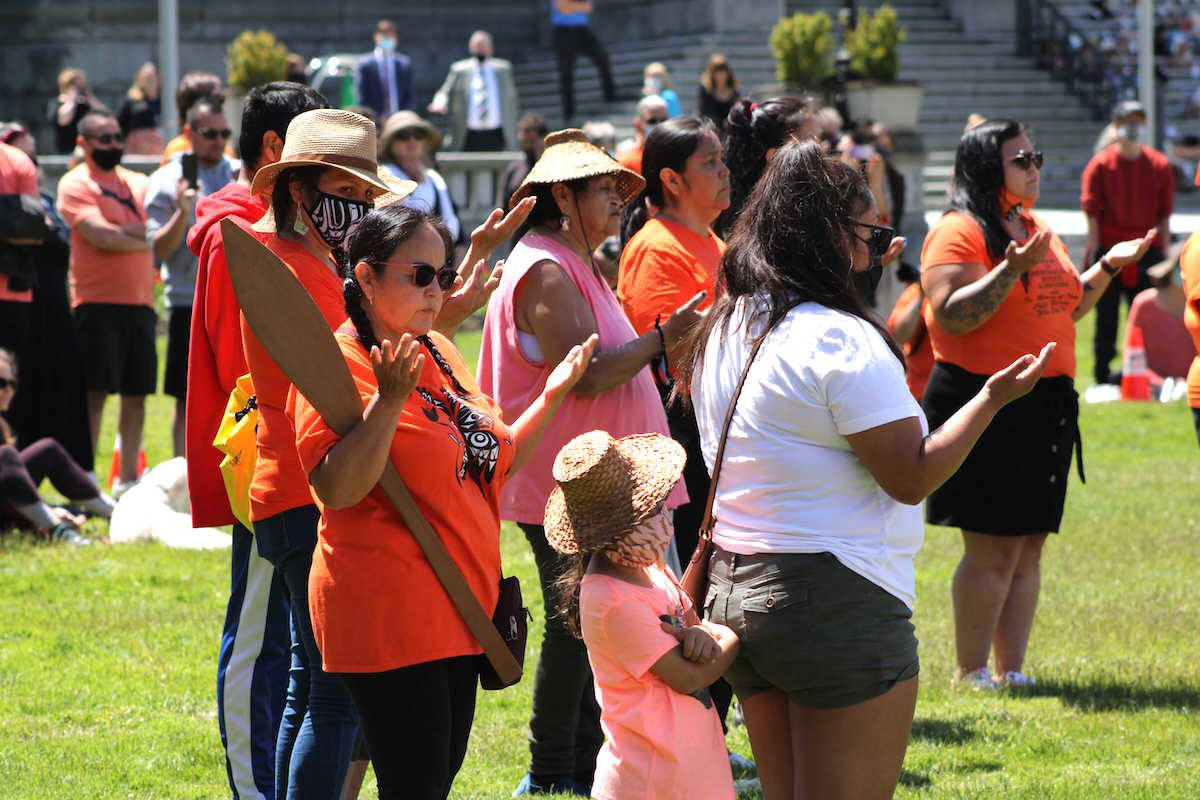 Vancouver Island First Nations and others gather on the lawn of the legislature to honour the 215 children who never came home from a Kamloops residential school. The timing of the discovery will affect Victoria's marking of July 1 as Canada Day this year. (Jake Romphf/News Staff)