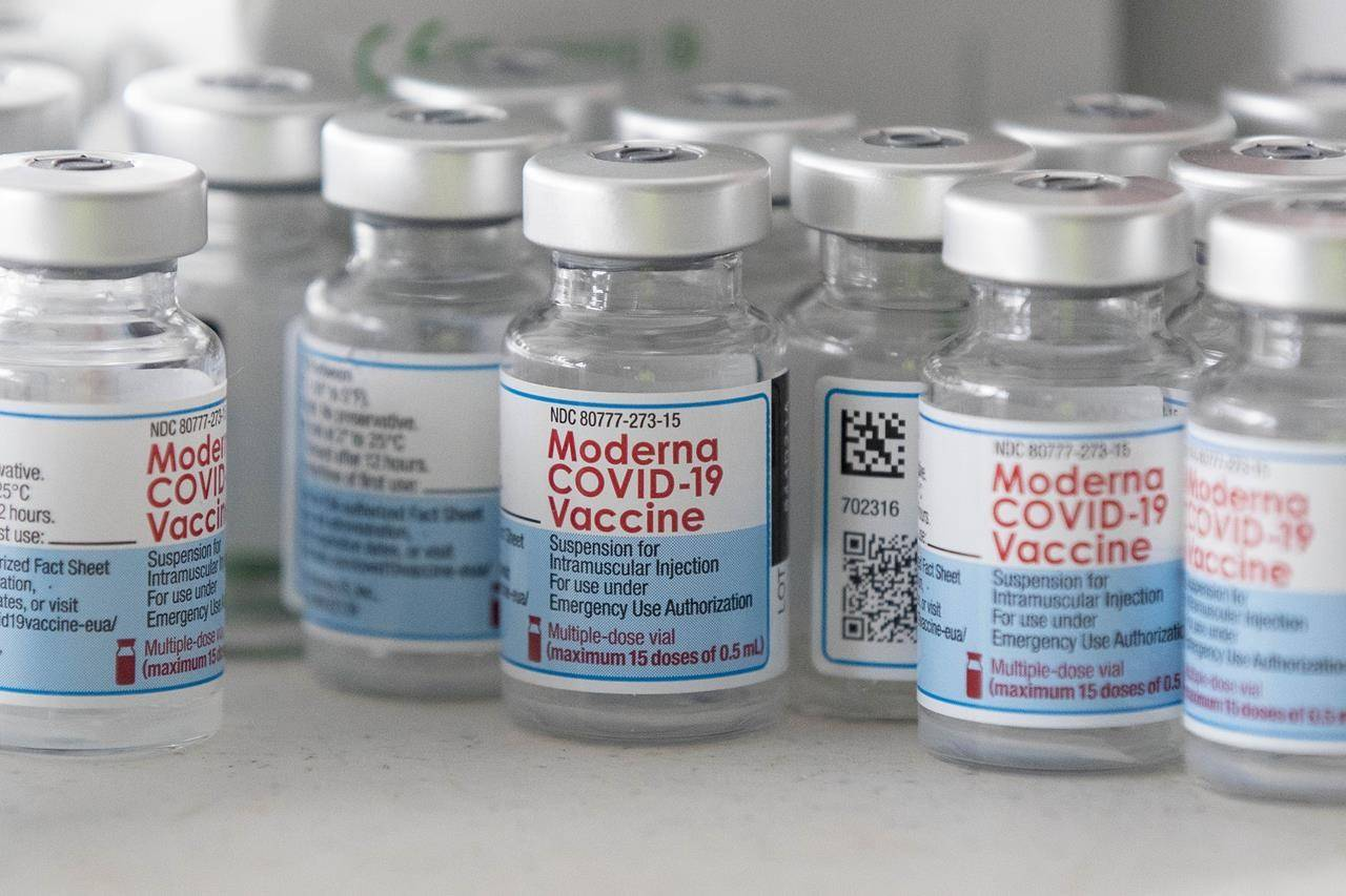 Empty Moderna vaccine vials are shown before a COVID-19 vaccine drive-thru clinic at Richardson stadium in Kingston, Ont., on Friday, July 2, 2021. THE CANADIAN PRESS/Lars Hagberg