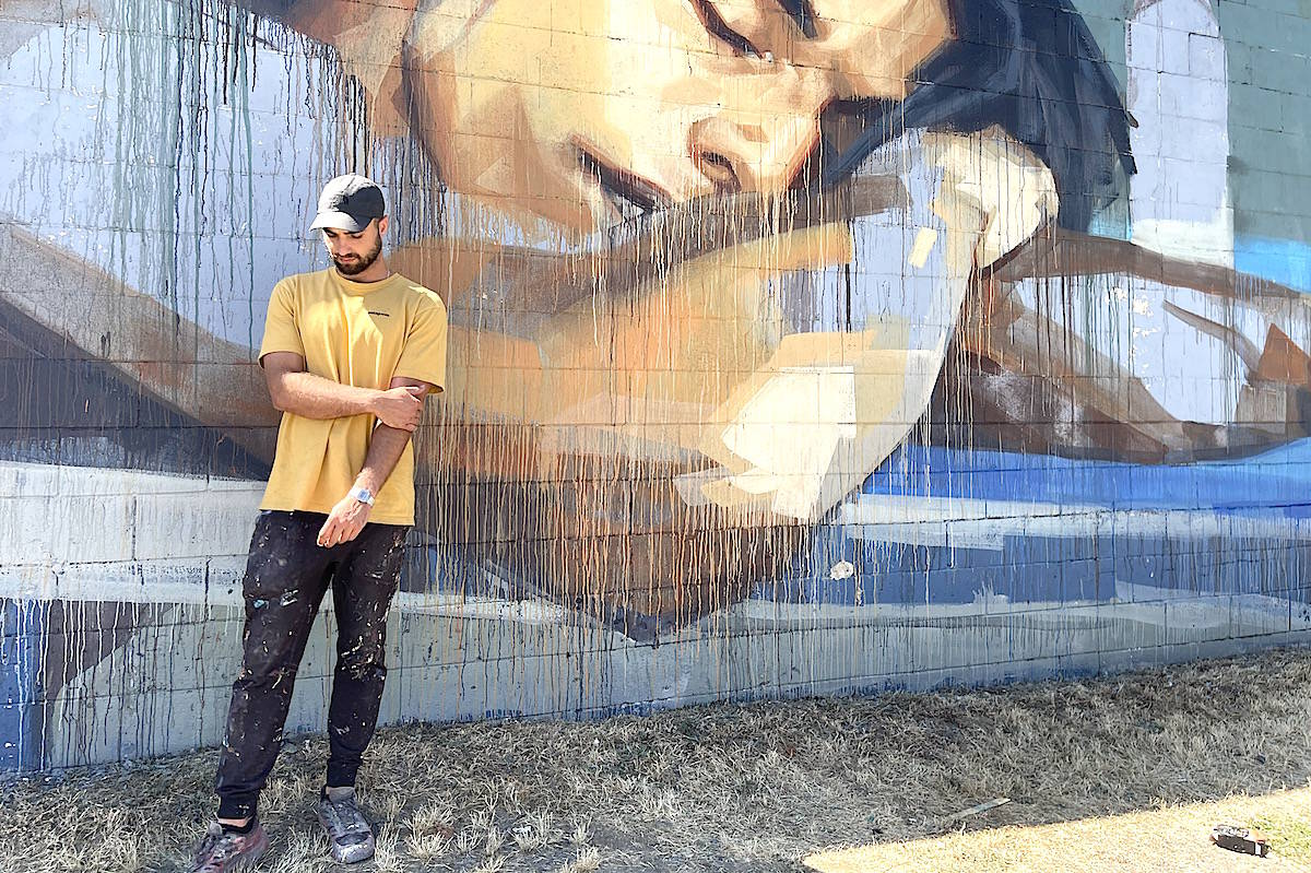 Muralist Emmanual Jarus of Toronto in front of his latest work in Chilliwack on July 24, 2021. Jennifer Feinberg/ Chilliwack Progress photo